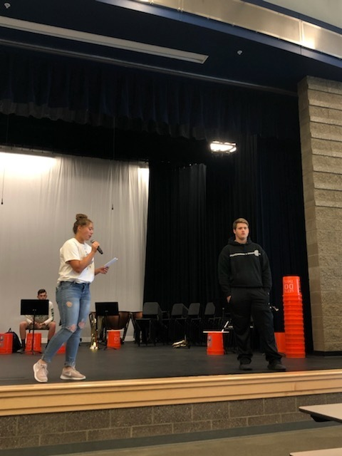 ASB President, Jenna Mendoza, leads students in recognizing Senior Golfer, Calin Hanson before he leaves to compete at State