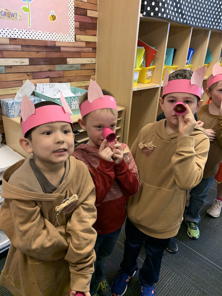 Little kids dressed up as piglets
